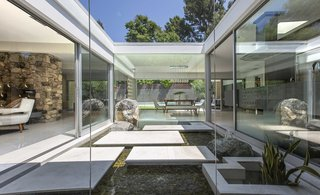 The home features a gorgeous glass atrium at its center.