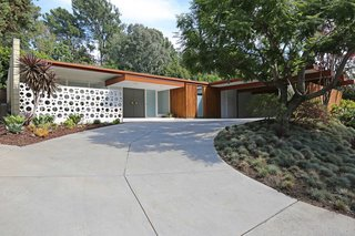The facade features a clean and classic midcentury profile.