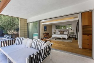 The master bedrooms open directly onto the outdoor space.