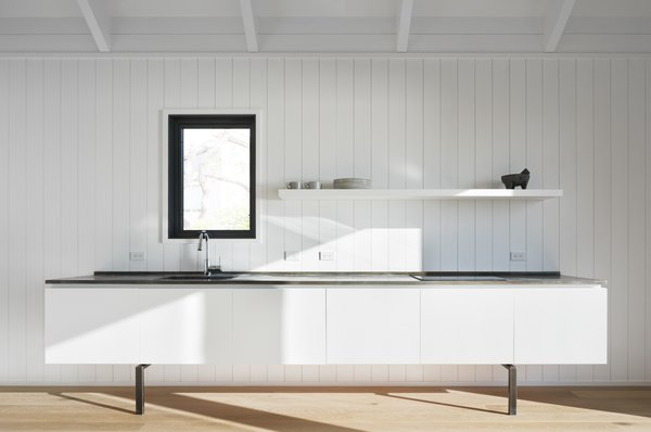The simple white kitchen.