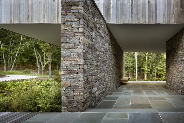 The home cantilevers out over the series of stone-retaining walls.
