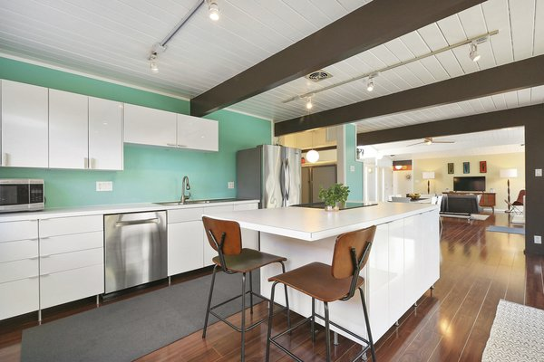 The kitchen has been remodeled and updated with a center island and stainless steel appliances.