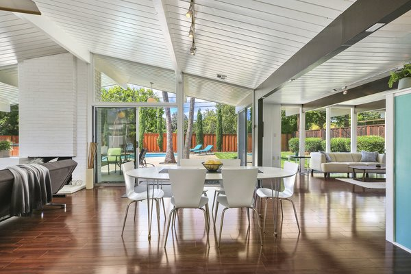The open floor plan features an impressive great room with vaulted ceilings which have been painted white.