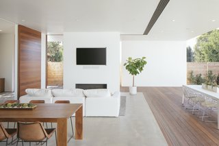 Keeping the region's temperate climate in mind, the architects have inserted sliding doors and operable windows throughout the home to enable ventilation and decrease the need for air conditioning.