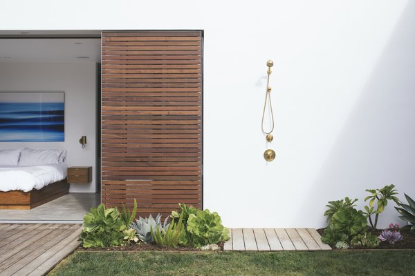With the home being located just minutes from the beach, the outdoor shower from Kohler's Purist collection is a perfect spot to rinse off after excursions.