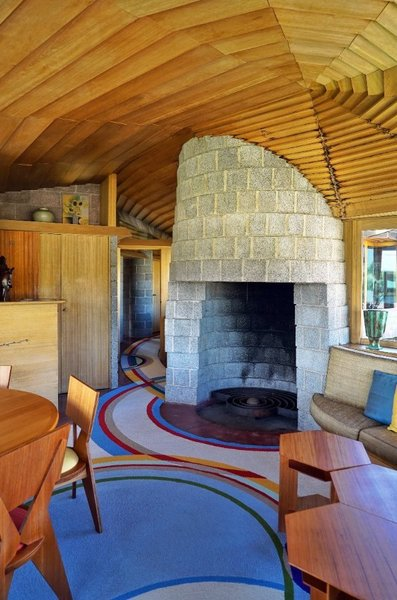 The concrete block fireplace.
