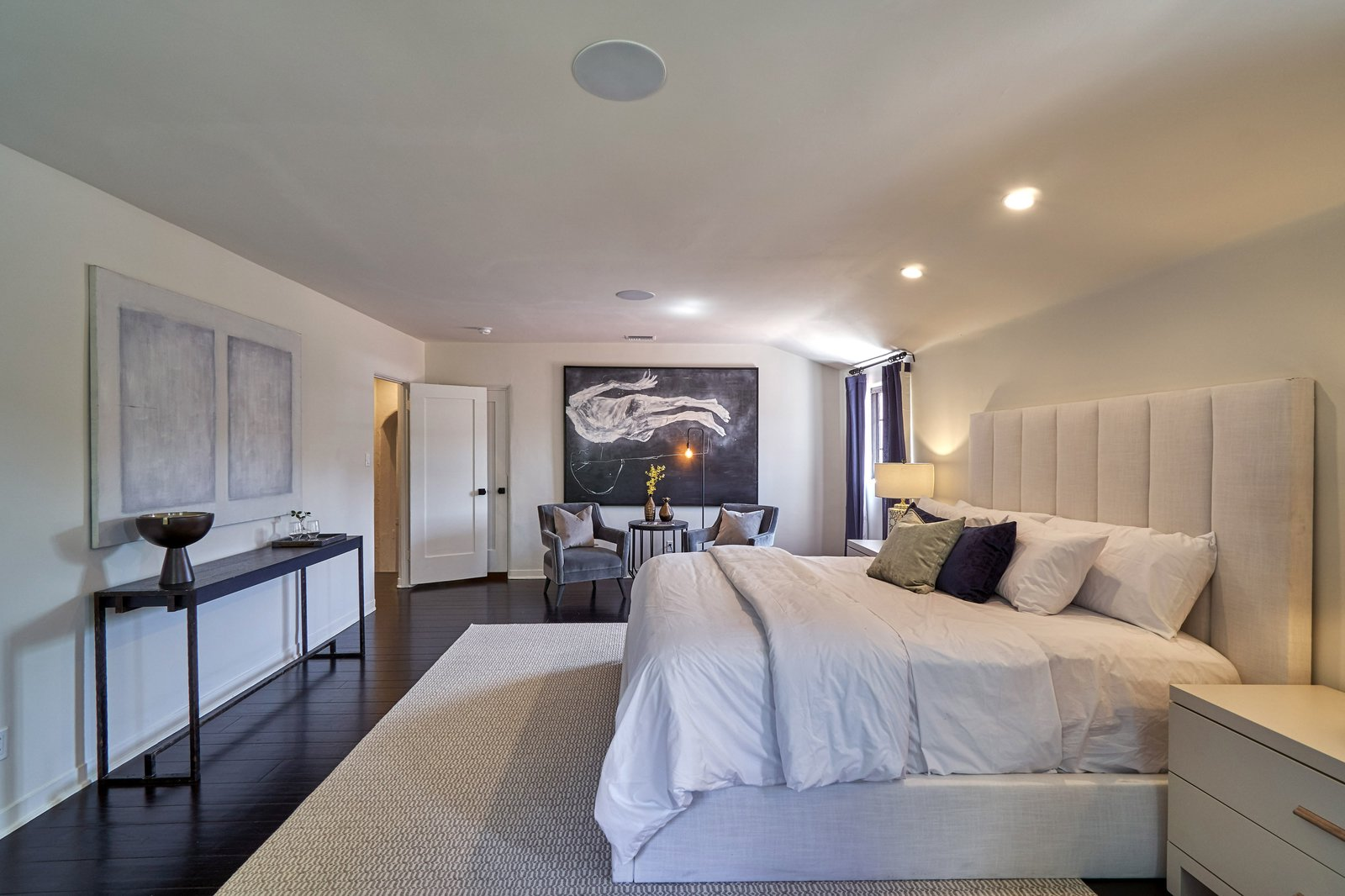 Bedroom, Dark Hardwood, Bed, Chair, Night Stands, Recessed, Dresser, Ceiling, and Rug The master suite boasts dual walk-in closets and an elegant ensuite bathroom.  Best Bedroom Bed Night Stands Dresser Ceiling Recessed Photos from Snatch Up James Dean's Former Hollywood Home For $4M