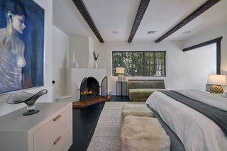 This bedroom even has its own wood-burning fireplace.