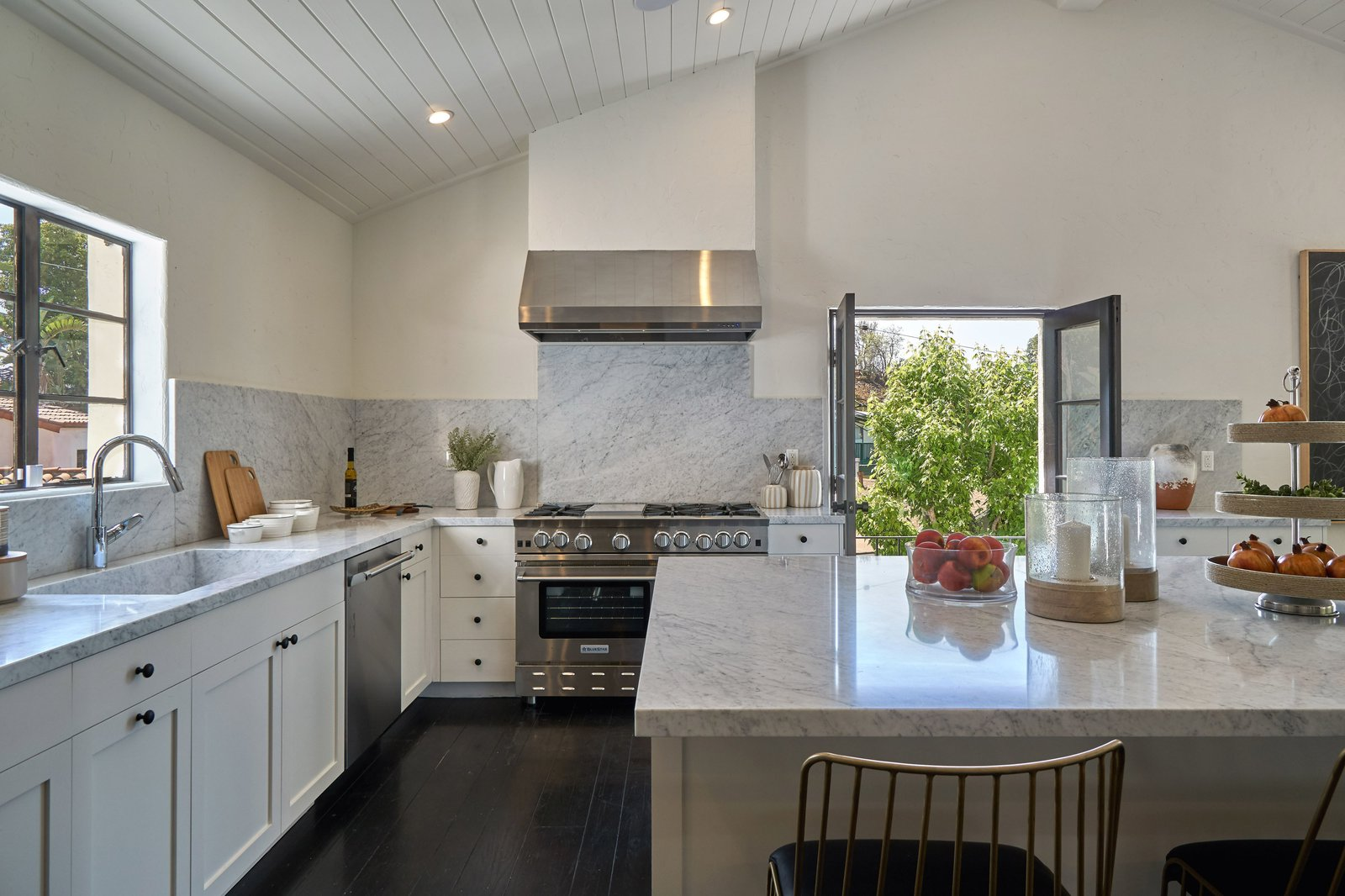 Kitchen, Ceiling, Dark Hardwood, Marble, White, Recessed, Range Hood, Vessel, Marble, Dishwasher, and Range The kitchen.  Best Kitchen Range Ceiling White Marble Dark Hardwood Photos from Snatch Up James Dean's Former Hollywood Home For $4M