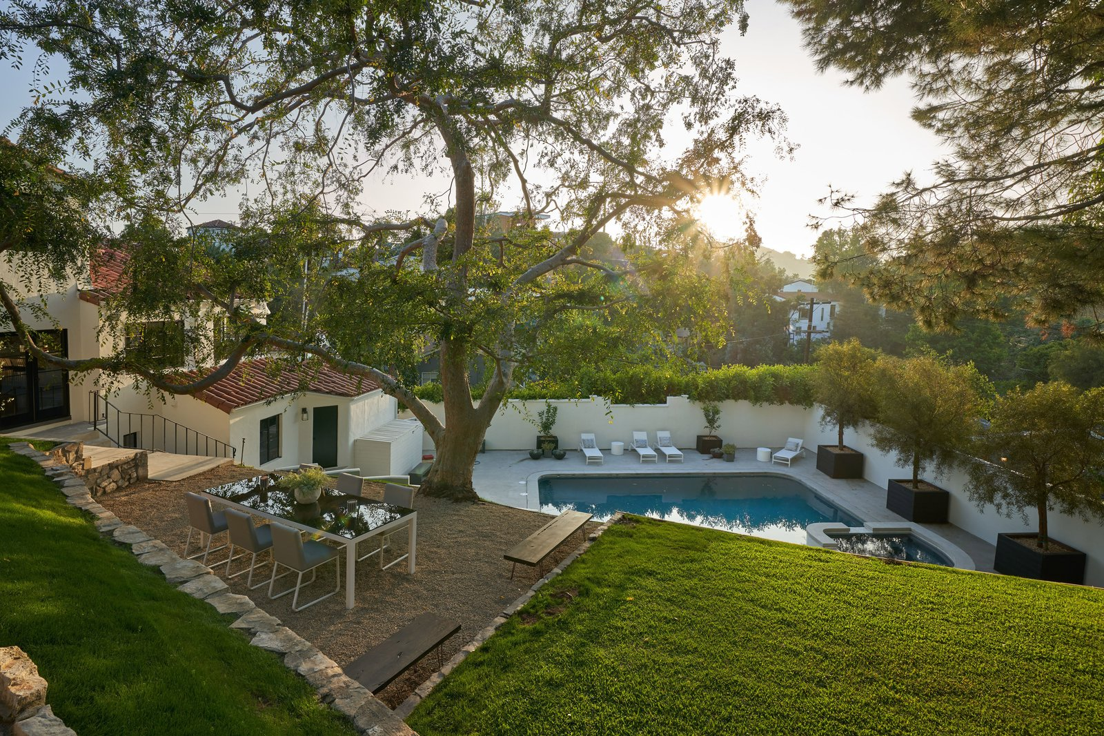 Outdoor, Concrete, Grass, Trees, Large, Large, Back Yard, and Shrubs The Hollywood Hills home sits on a high bluff and features stunning canyon views.    Best Outdoor Concrete Grass Photos from Snatch Up James Dean's Former Hollywood Home For $4M