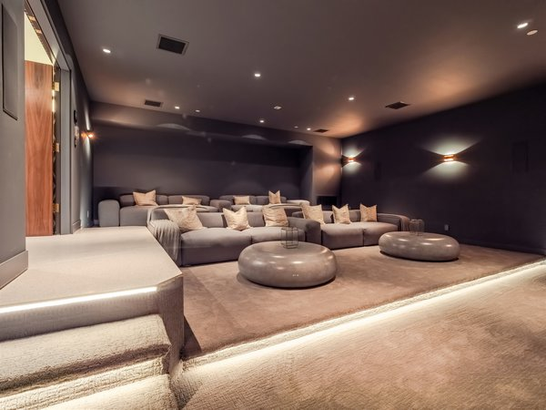 An additional lower level has a large stadium seating with 9.1 surround sound speakers in the walls, and is ready to accommodate a 120-inch  screen and projector.