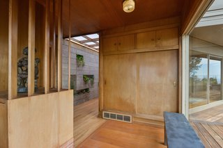 Charming midcentury features like the original wood paneling exist throughout.