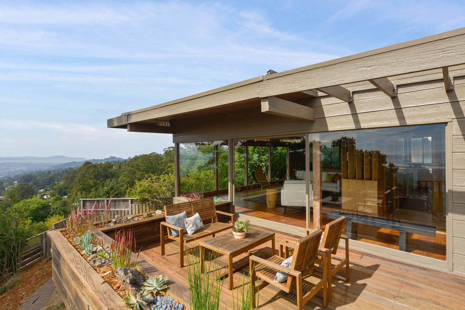 Outdoor, Wood, Planters, Small, Back Yard, Gardens, and Trees This is the deck off the living room.  Best Outdoor Wood Gardens Photos from A Berkeley Midcentury With Jaw-Dropping Views Asks $945K