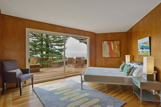 This bedroom has sliding doors leading out the deck.