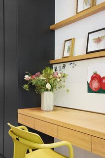 This gorgeous kitchen/office nook in a revamped Edwardian by Paul Raff Studio incorporates some of the best home office ideas for her. Rather than having a dedicated office space, manage the household in this small but tastefully feminine space featuring flowers and pastel-hued artwork.