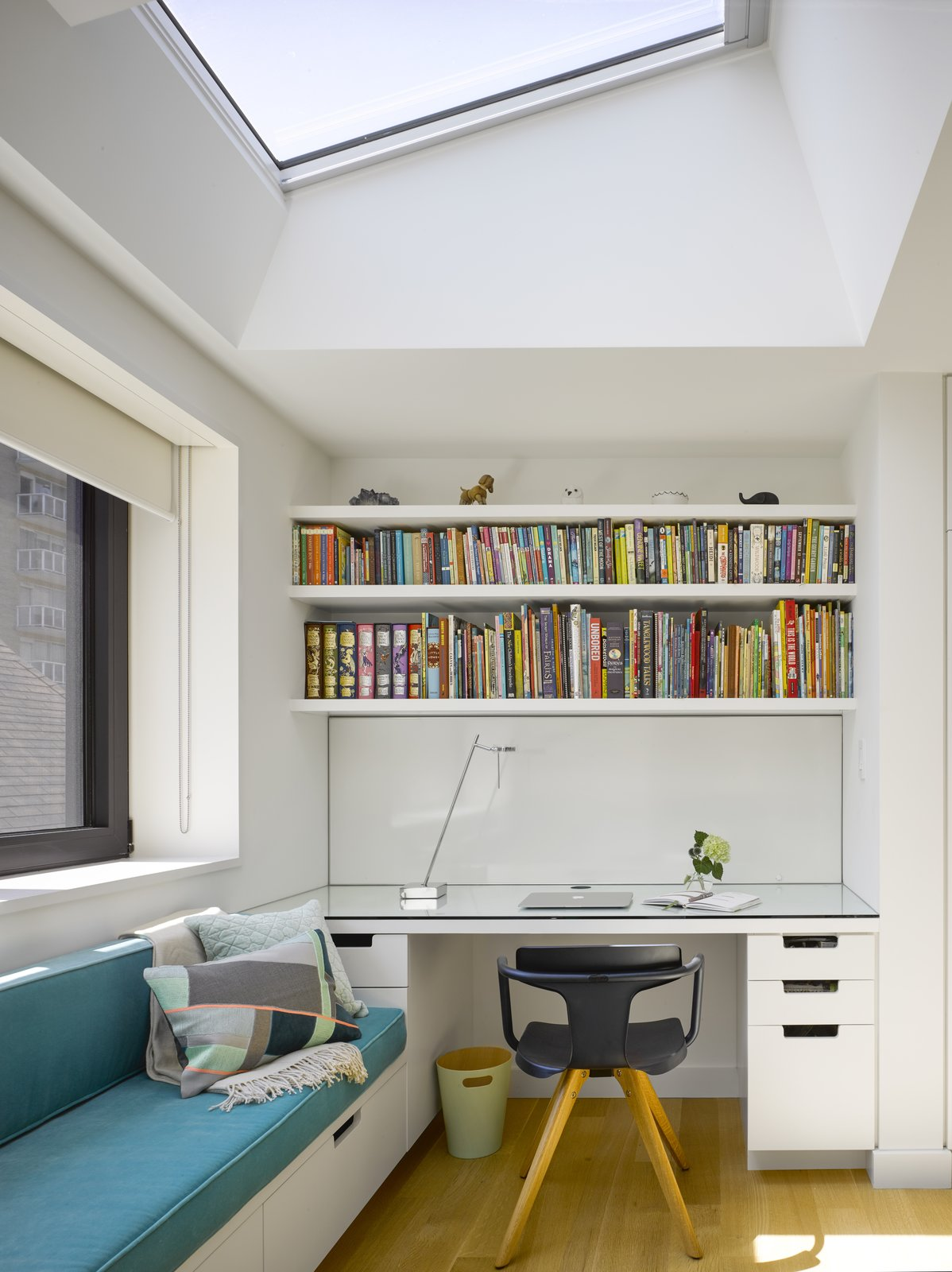 Office, Desk, Light Hardwood Floor, Study Room Type, Shelves, Storage, Bookcase, Chair, and Lamps A detail of the office nooks with a teal daybed and built-in shelving.   Photos from An Elegant Edwardian Home Is Treated to a Thoughtful Revamp