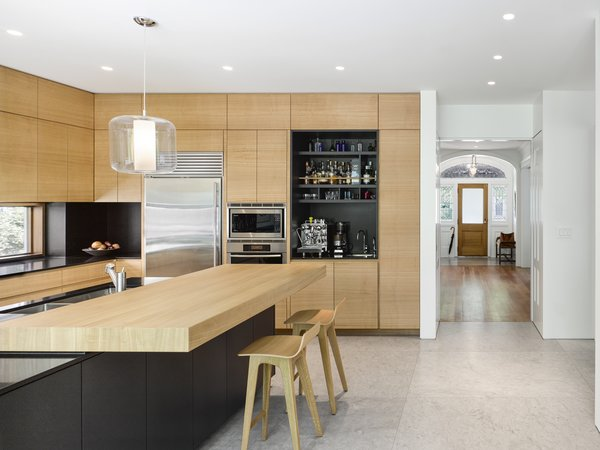 At the back of the home, a new extension includes a spacious, modern kitchen.