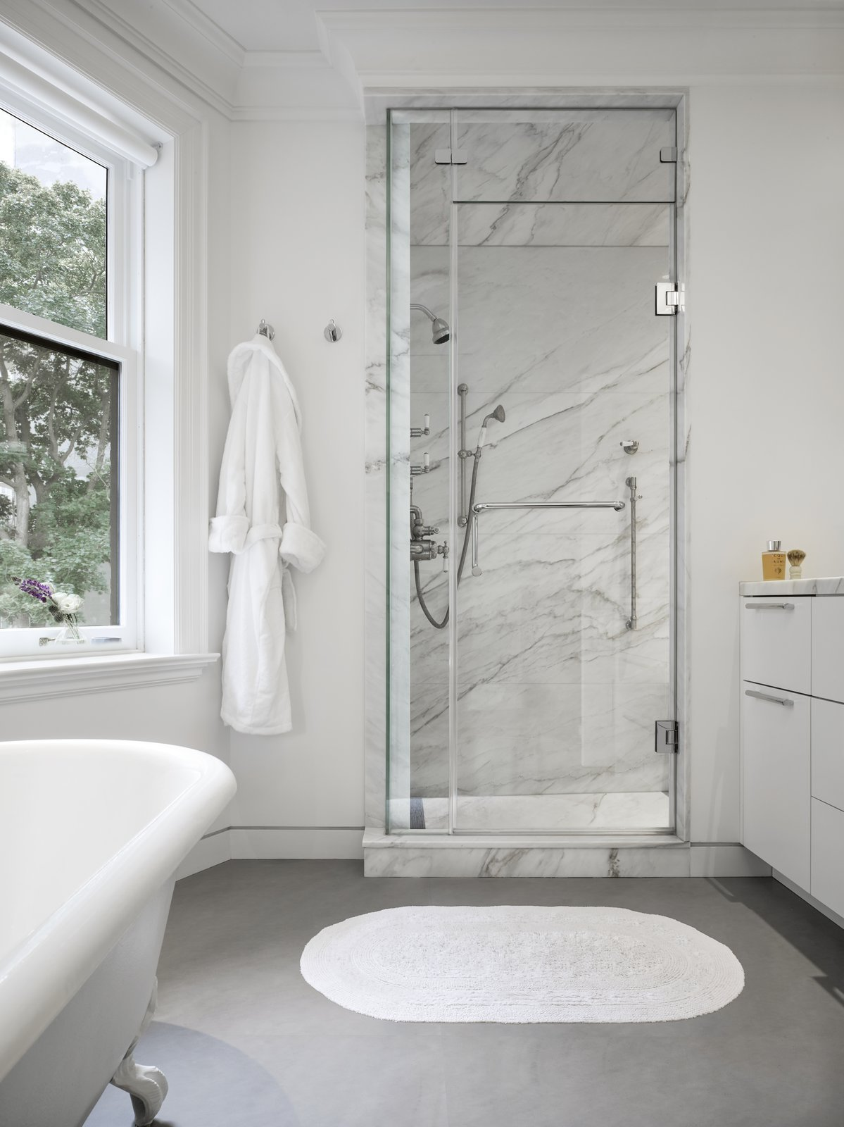 Bath, Enclosed, Freestanding, Marble, Slate, and Rug The master bedroom also has a marble-clad ensuite bathroom.   Bath Freestanding Enclosed Slate Photos from An Elegant Edwardian Home Is Treated to a Thoughtful Revamp