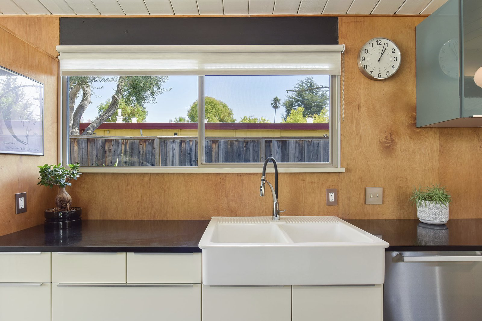Kitchen, Vessel, Dishwasher, White, and Wood The double sink.  Kitchen Dishwasher Vessel Photos from This Stunning Bay Area Eichler Just Listed For $775K