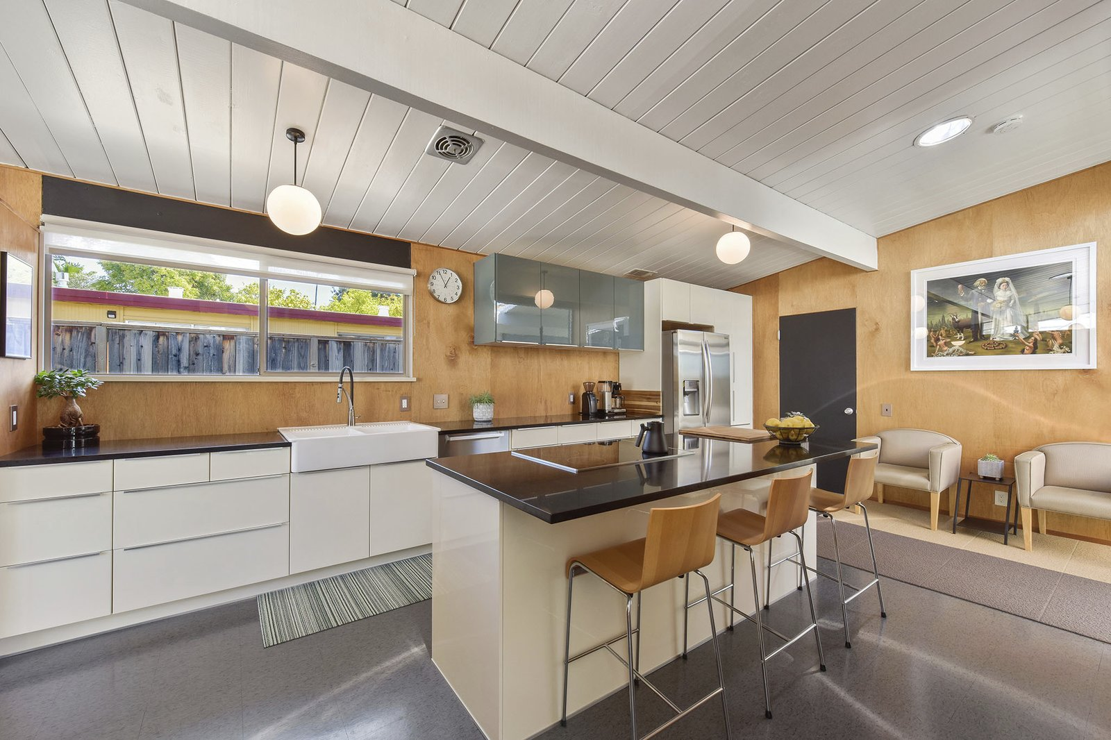 Kitchen, Refrigerator, Wood, Pendant, Cooktops, Vessel, White, and Dishwasher The home also features a double farmhouse sink and high-end stainless steel appliances.    Kitchen Dishwasher Refrigerator Vessel Photos from This Stunning Bay Area Eichler Just Listed For $775K