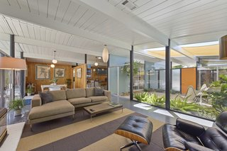 Expansive walls of glass bring a strong sense of the outdoors in.