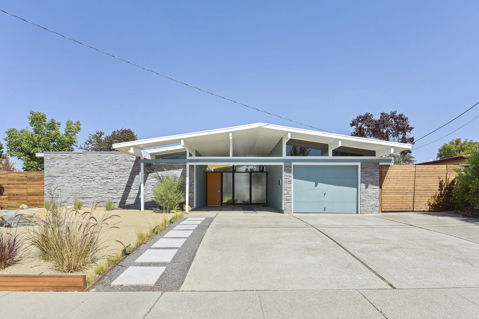 Exterior, Glass, Shingles, House, Brick, Wood, Gable, Mid-Century, and Stone Beautifully renovated, the home has excellent curb appeal with low maintenance landscaping.    Best Exterior Shingles Glass Brick Mid-Century Photos from This Stunning Bay Area Eichler Just Listed For $775K