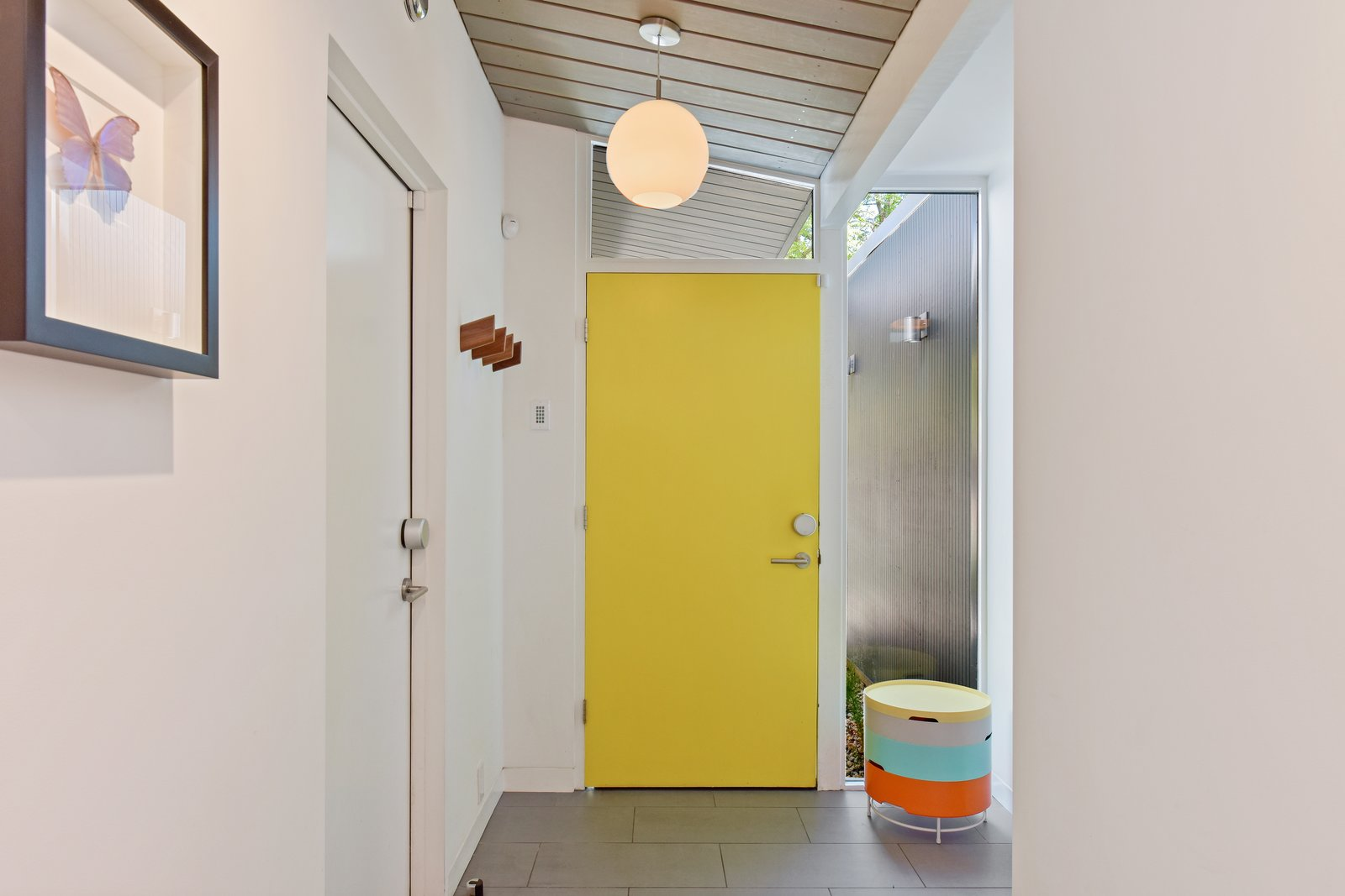 Hallway and Slate The front entry.   Hallway Slate Photos from Snag This Thoughtfully Modernized Eichler For $1.2M