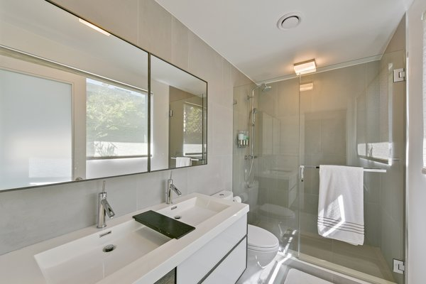 Both bathrooms are beautifully updated with porcelain flooring, plus radiant heating and cooling technology.