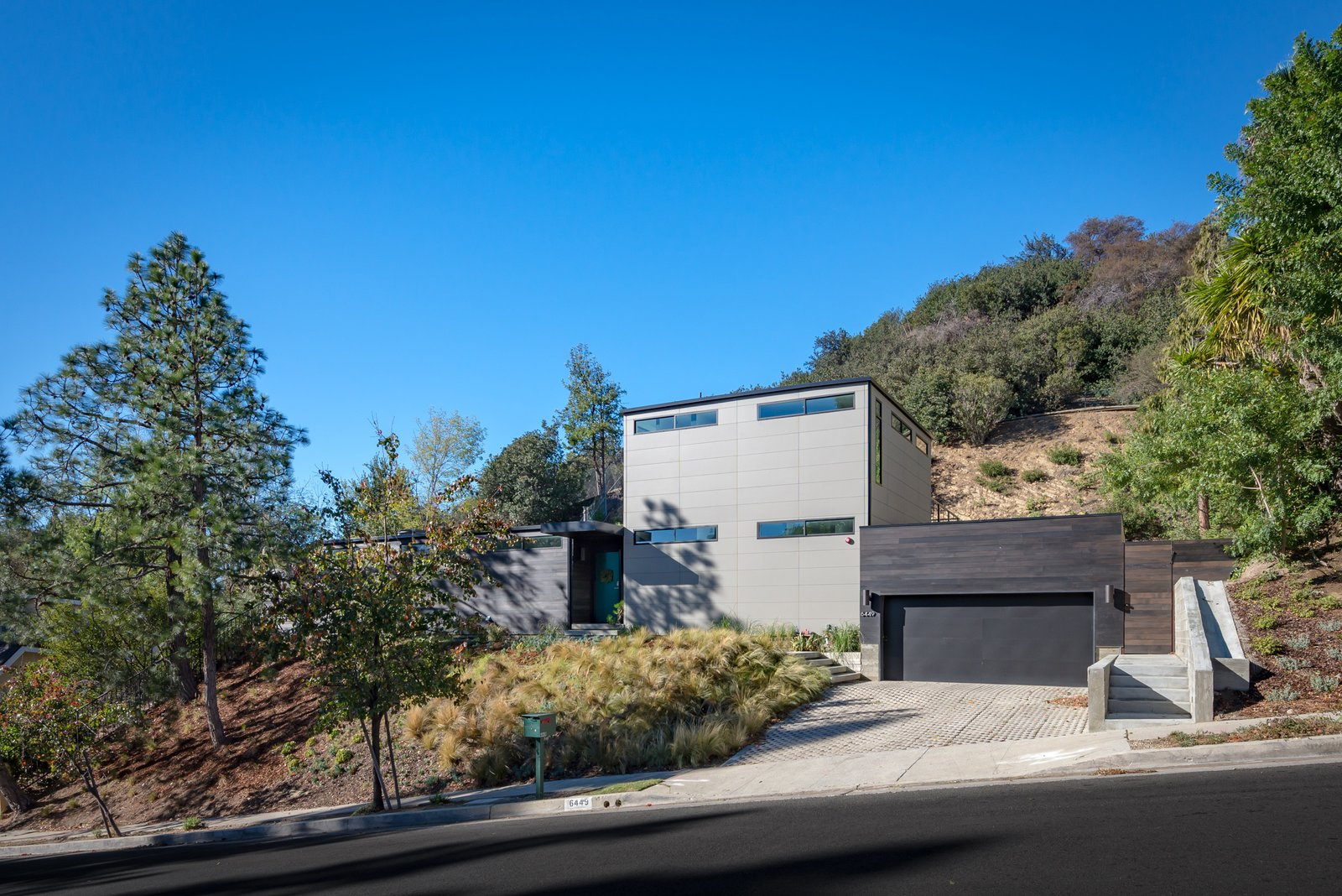 Exterior, Prefab Building Type, Metal Roof Material, House Building Type, Wood Siding Material, Metal Siding Material, and Flat RoofLine This boxy contemporary prefab in Hollywood was a custom-built for a client.   Photo 8 of 21 in Here Are the Modern Prefab Designs That Amazon's Investing In