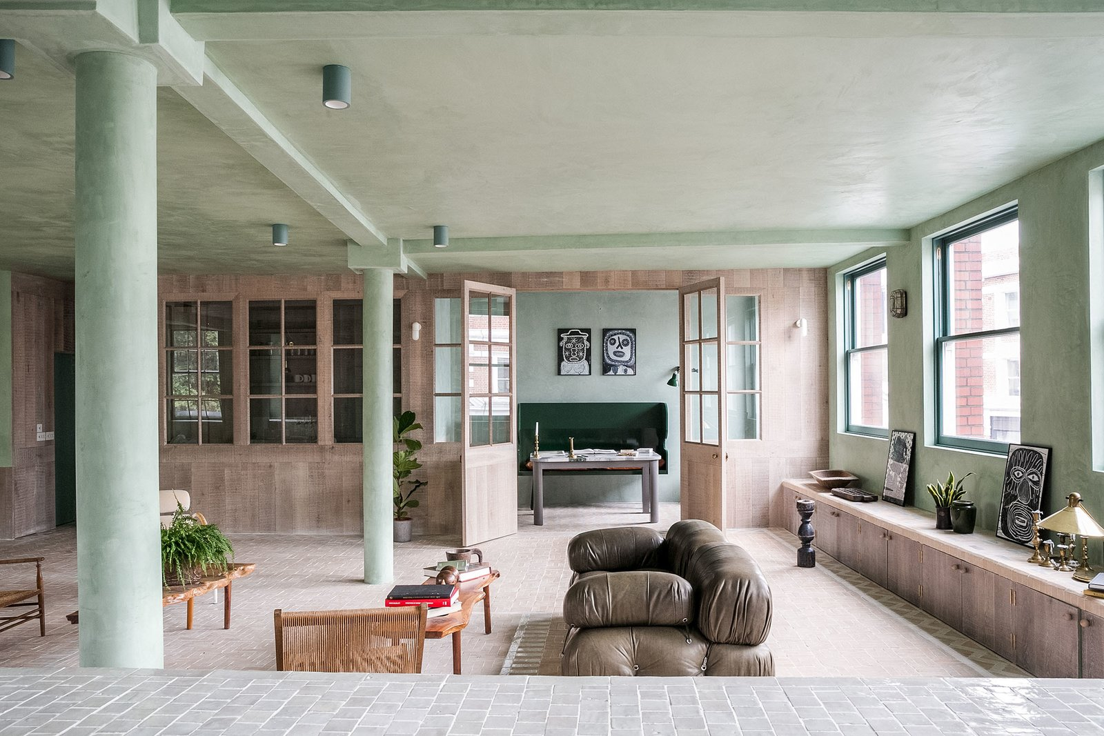 Living, Chair, Sofa, Bench, Terra-cotta Tile, and Ceiling The living space has french doors leading to a separate study.  Best Living Terra-cotta Tile Ceiling Photos from Grab This Newly Renovated, Green-Hued Abode For $4.2M