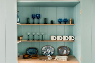Bespoke kitchen shelving provides a beautiful space to display special pieces.