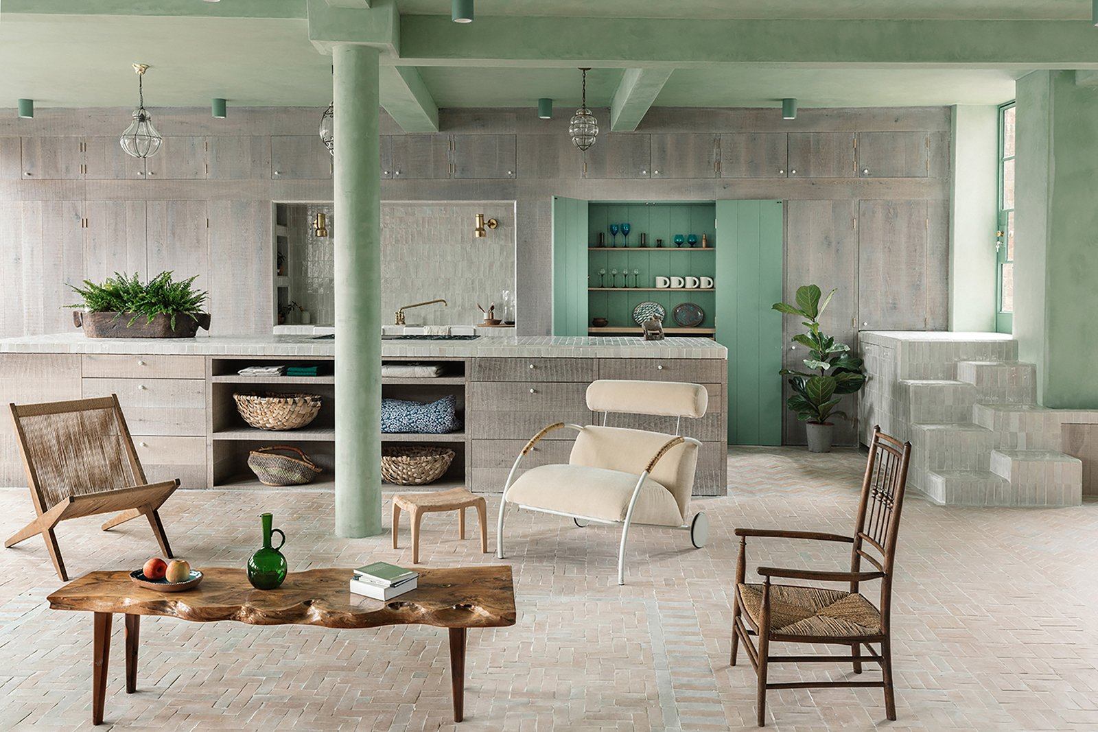 Living Room, Coffee Tables, Chair, Ceiling Lighting, and Terra-cotta Tile Floor  The kitchen island has been custom-made. The distinctive Zyklus lounger is by Peter Maly.     Photo 2 of 12 in Grab This Newly Renovated, Green-Hued Abode For $4.2M