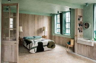 The second bedroom with woven linen shutters by Christabel Balfour.