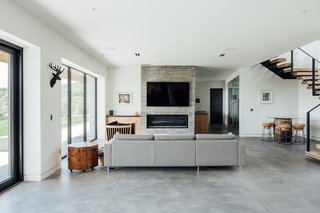 The lower level also features has a board-formed concrete fireplace.