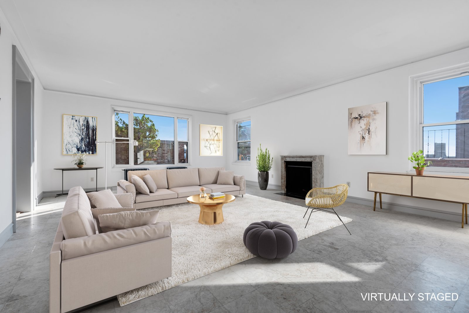 Living Room, Sofa, Standard Layout Fireplace, Chair, Coffee Tables, End Tables, Ottomans, Console Tables, Concrete Floor, and Rug Floor The light-filled living room.   Photo 6 of 12 in Björk Puts Her Brooklyn Heights Penthouse on the Market For $9M