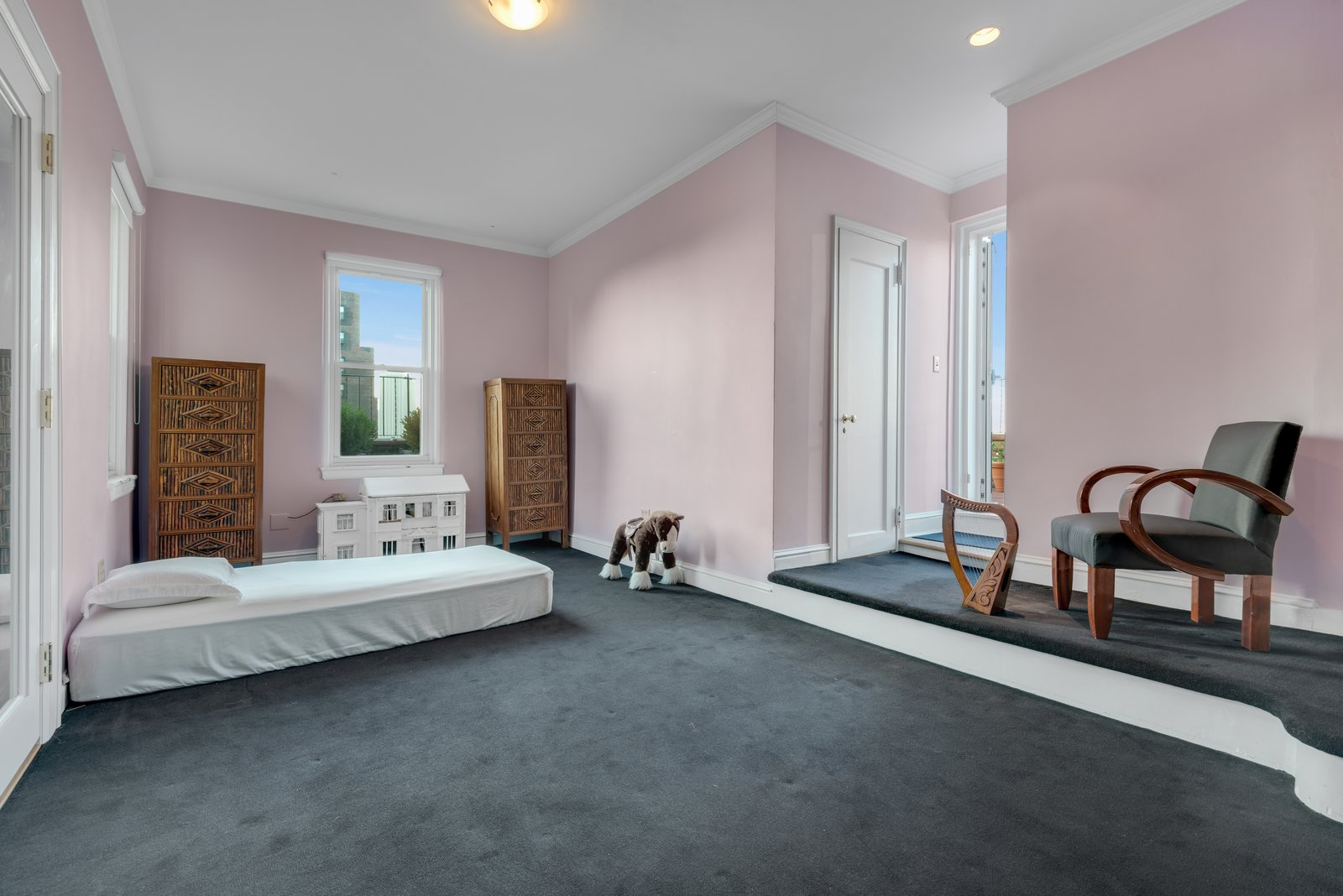 Kids Room, Girl Gender, Dresser, Carpet Floor, Chair, Bedroom Room Type, Bed, and Pre-Teen Age One of the other four bedrooms.   Photo 8 of 12 in Björk Puts Her Brooklyn Heights Penthouse on the Market For $9M