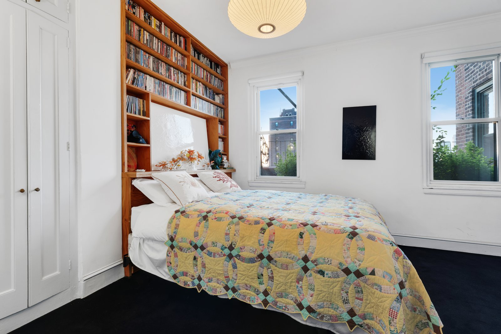 Bedroom, Pendant Lighting, Bed, Shelves, Bookcase, and Carpet Floor Built-in shelving in another bedroom holds more than enough bedtime reading.  Photo 10 of 12 in Björk Puts Her Brooklyn Heights Penthouse on the Market For $9M