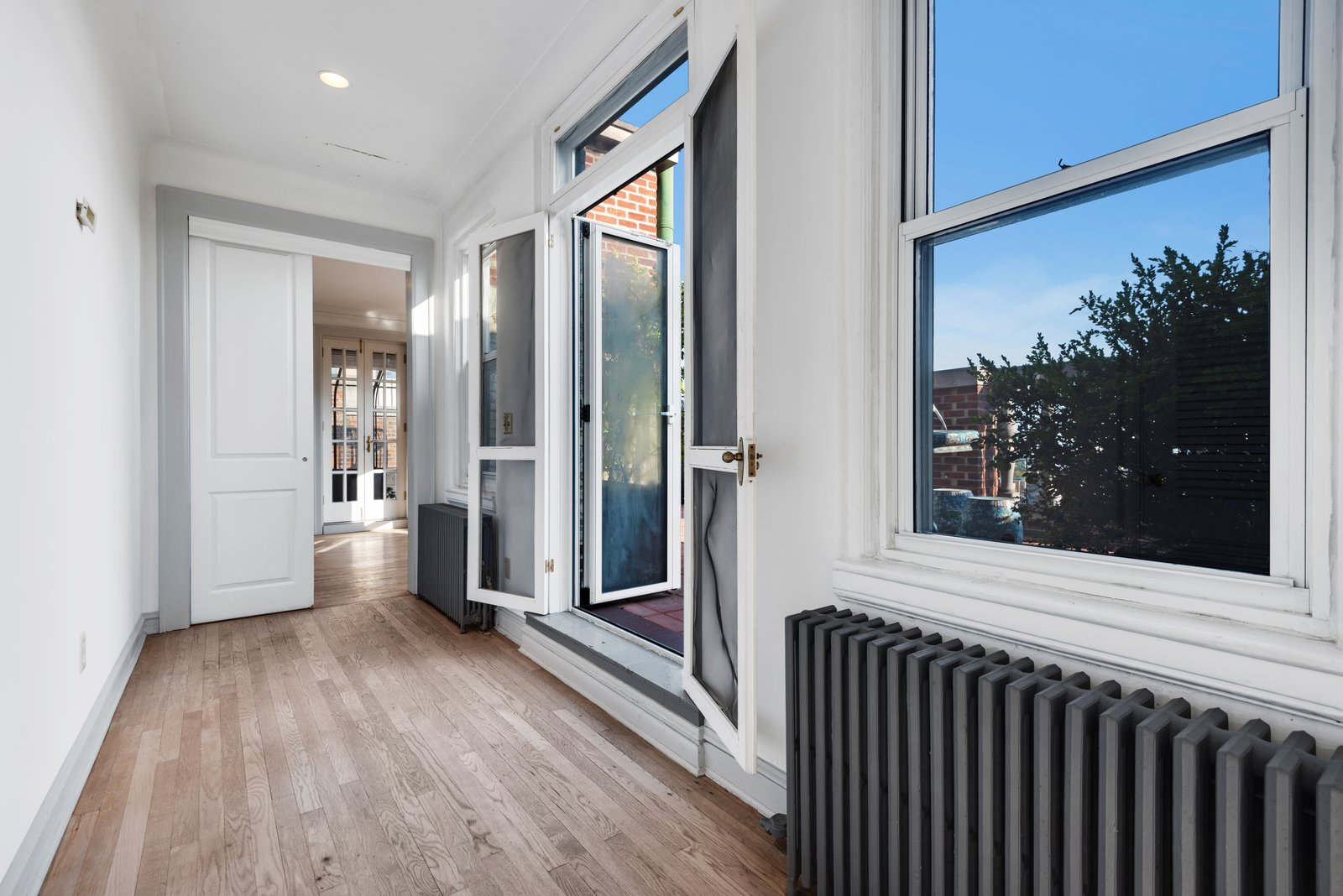 Hallway and Light Hardwood Floor A door leads out to the terrace.   Photo 11 of 12 in Björk Puts Her Brooklyn Heights Penthouse on the Market For $9M