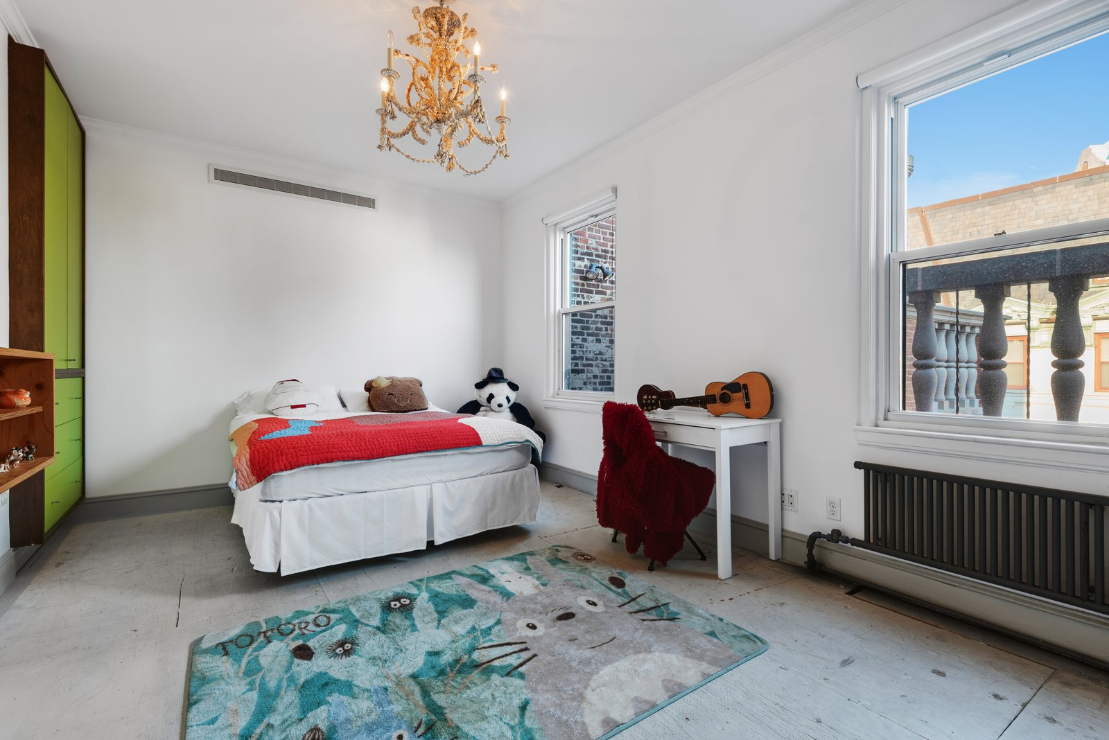 Kids Room, Bed, Neutral Gender, Desk, Bedroom Room Type, Pre-Teen Age, Storage, Concrete Floor, Bookcase, and Chair The child's bedroom.   Photo 7 of 12 in Björk Puts Her Brooklyn Heights Penthouse on the Market For $9M