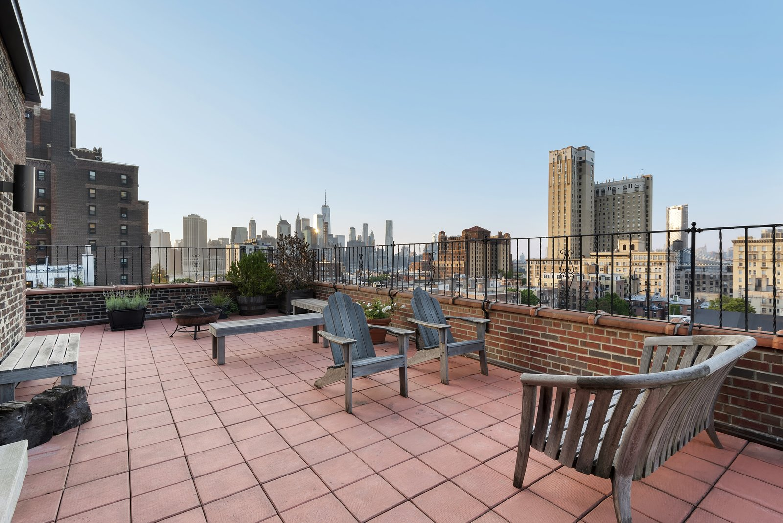 Outdoor, Rooftop, Large Patio, Porch, Deck, Hanging Lighting, Vertical Fences, Wall, Tile Patio, Porch, Deck, Raised Planters, and Metal Fences, Wall The terrace also features killer New York City views.   Photo 3 of 12 in Björk Puts Her Brooklyn Heights Penthouse on the Market For $9M