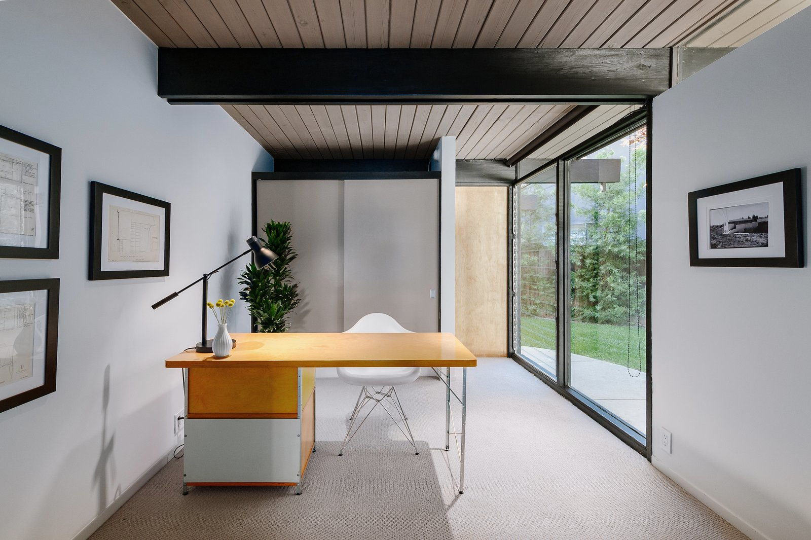 Office, Study Room Type, Desk, Chair, and Carpet Floor The third bedroom is currently configured as office space.     Photo 8 of 9 in Picture Yourself in This Historic L.A. Midcentury For $2.6M