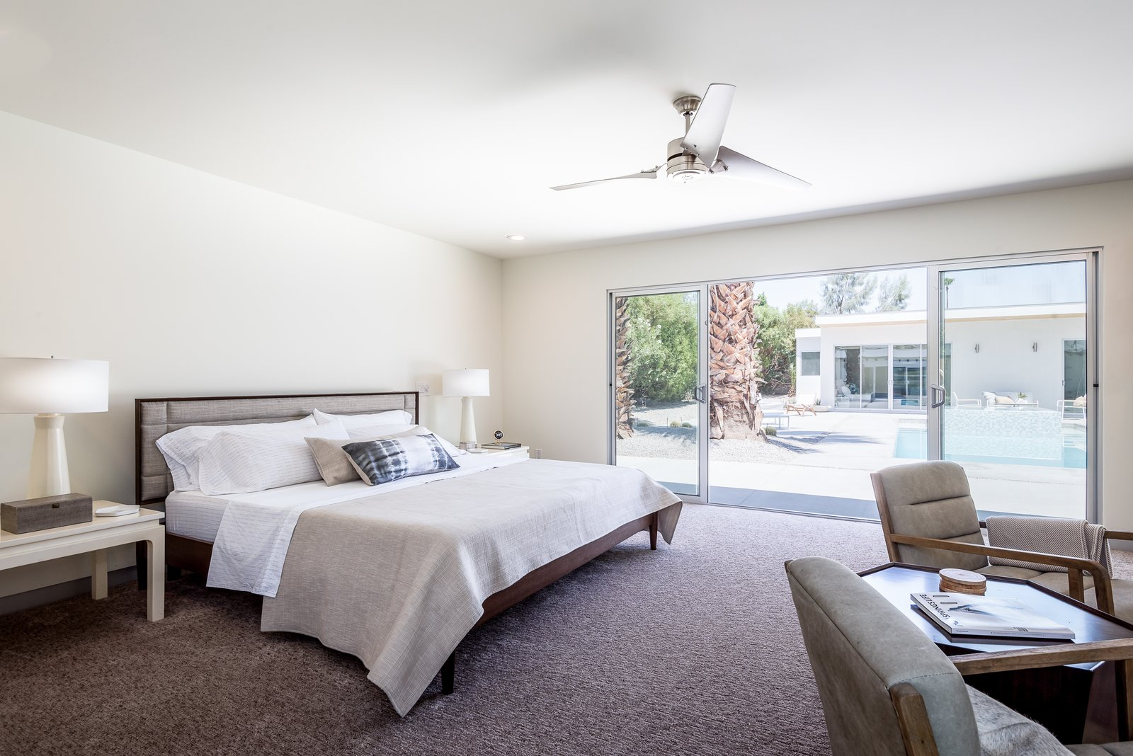 Bedroom, Chair, Bed, Night Stands, Carpet, Ceiling, and Recessed There are two master suites, both of which feature stand-alone tubs and walk-in showers.    Bedroom Carpet Chair Ceiling Photos from An Updated Palm Springs Estate Lists For $2.4M