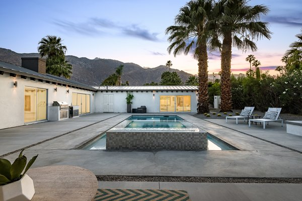 The resort-like outdoor space features breathtaking views of the surrounding mountain range.