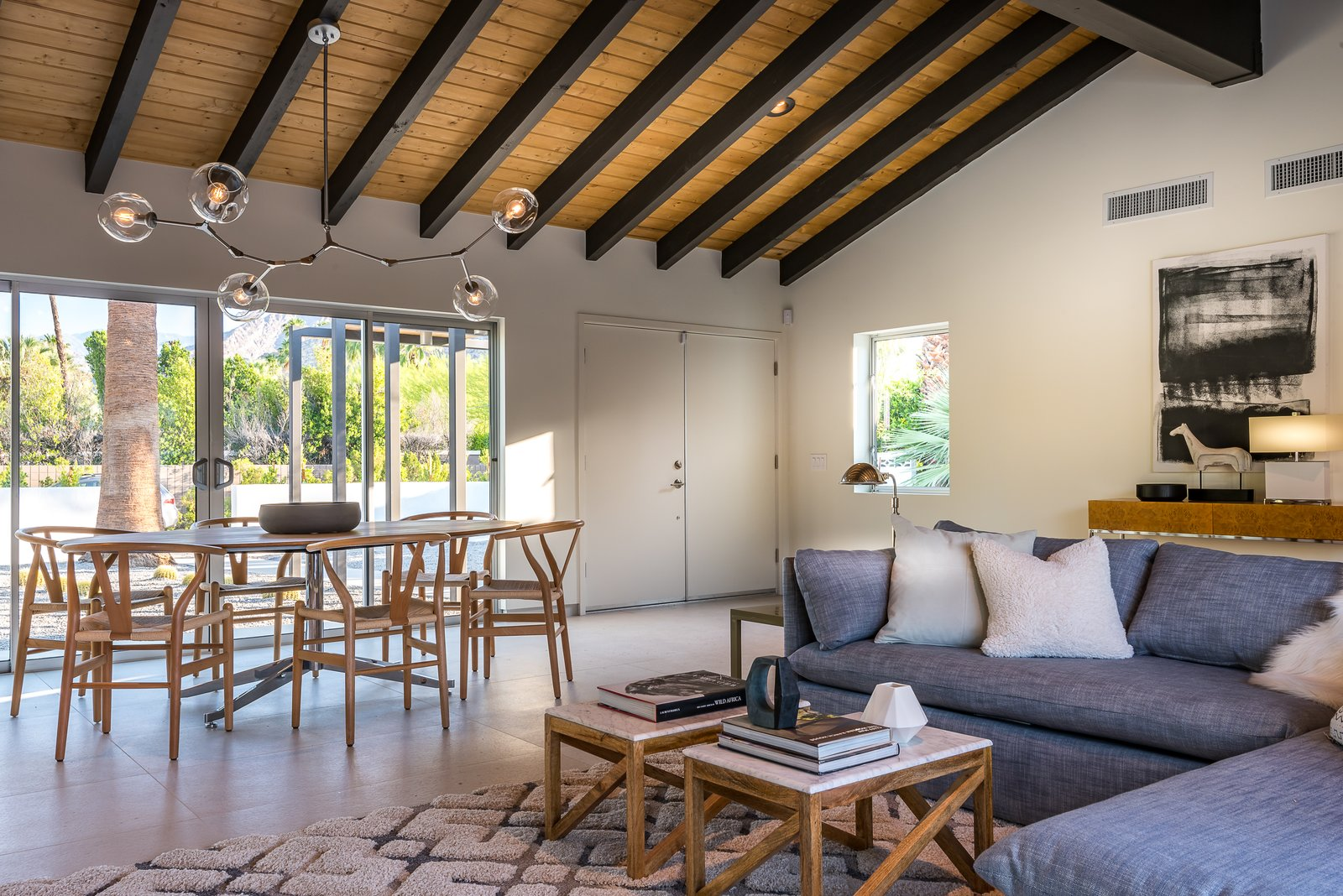 Living, Recessed, Accent, Sectional, Chair, Ceiling, Table, and Coffee Tables The great room features an open floor plan, as well as a vaulted tongue-and-groove ceiling.     Best Living Ceiling Table Photos from An Updated Palm Springs Estate Lists For $2.4M