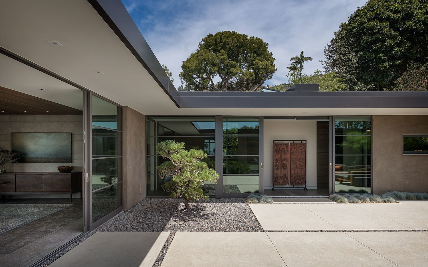 Exterior, House Building Type, Flat RoofLine, Mid-Century Building Type, and Concrete Siding Material A quiet moment of light and shadow highlights the home's Japanese influence.  Photo 4 of 23 in A Southern California Midcentury Gets a Serene, Japanese-Inspired Treatment