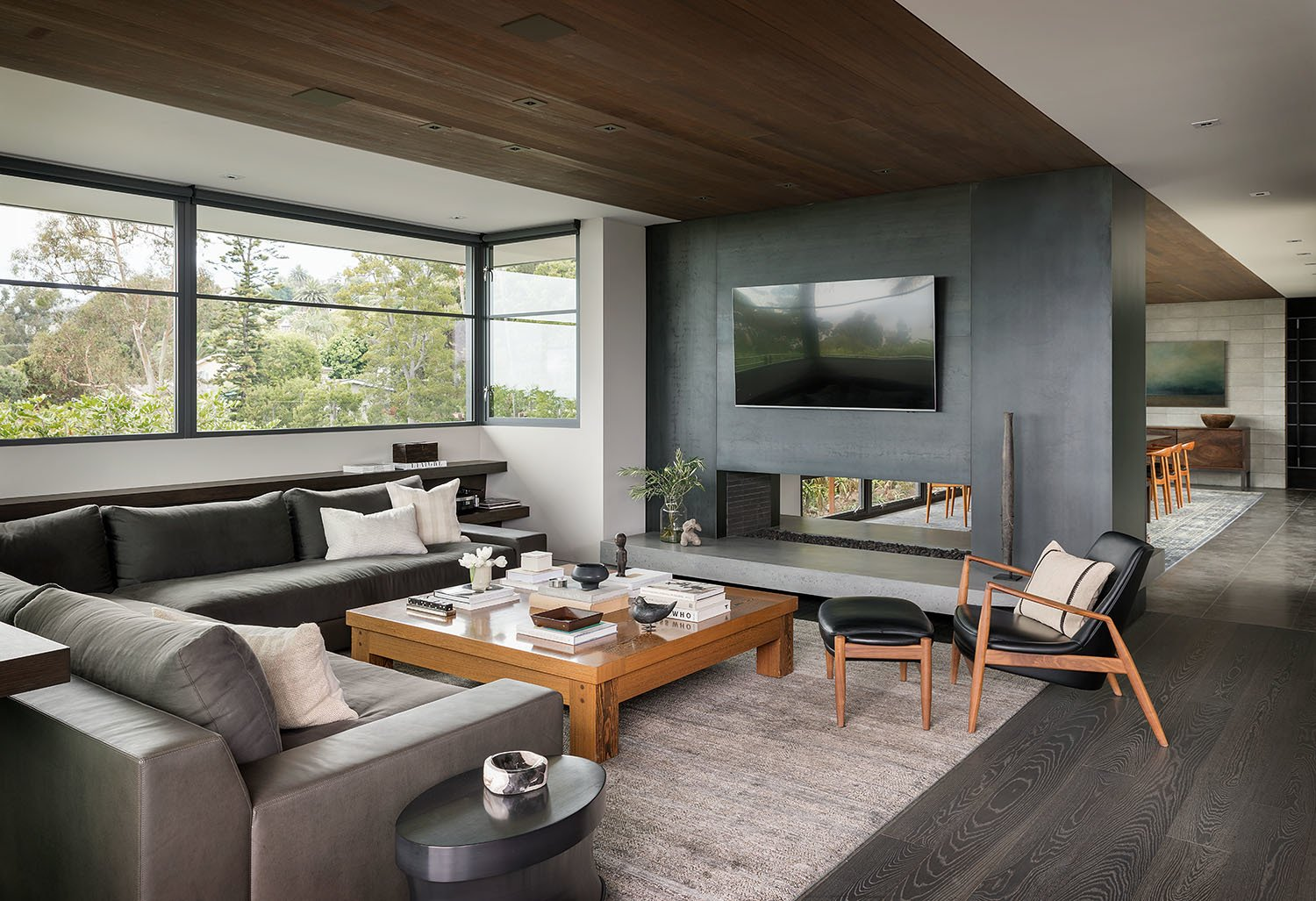 Living, Sofa, Chair, Coffee Tables, Rug, Ceiling, Dark Hardwood, Ottomans, Recessed, and Two-Sided On the other side of the Cor-Ten fireplace is the living room. The custom Augustin sectional and the cocktail table are from Christian Liaigre, and paired with Ib Kofod-Larsen's Seal chair and ottoman.  Best Living Two-Sided Ceiling Photos from A Southern California Midcentury Gets a Serene, Japanese-Inspired Treatment