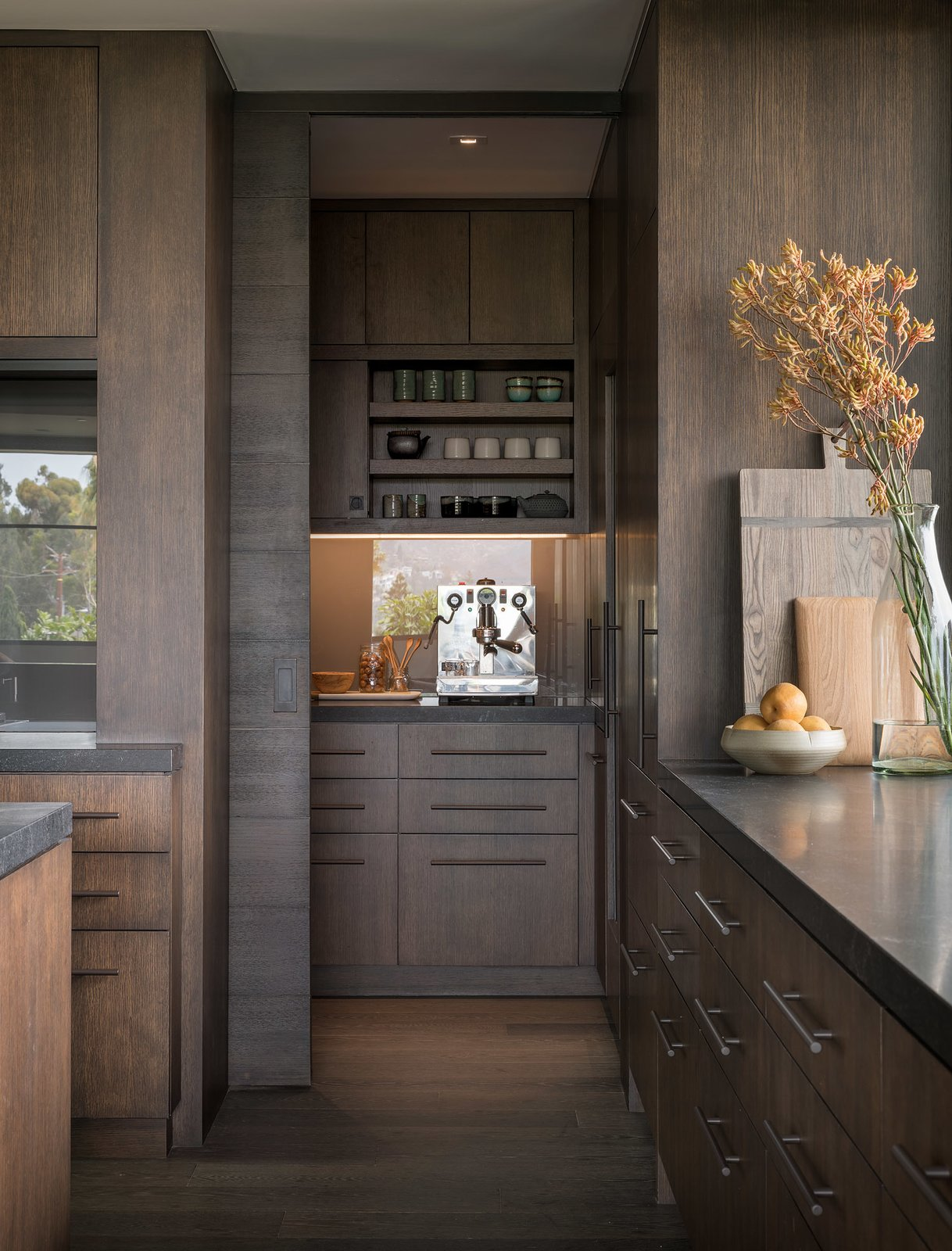 Kitchen, Dark Hardwood, Wood, Ceiling, Granite, and Recessed The kitchen features custom-stained, white oak cabinetry and honed granite countertops—plus plenty of storage.  Best Kitchen Ceiling Dark Hardwood Photos from A Southern California Midcentury Gets a Serene, Japanese-Inspired Treatment