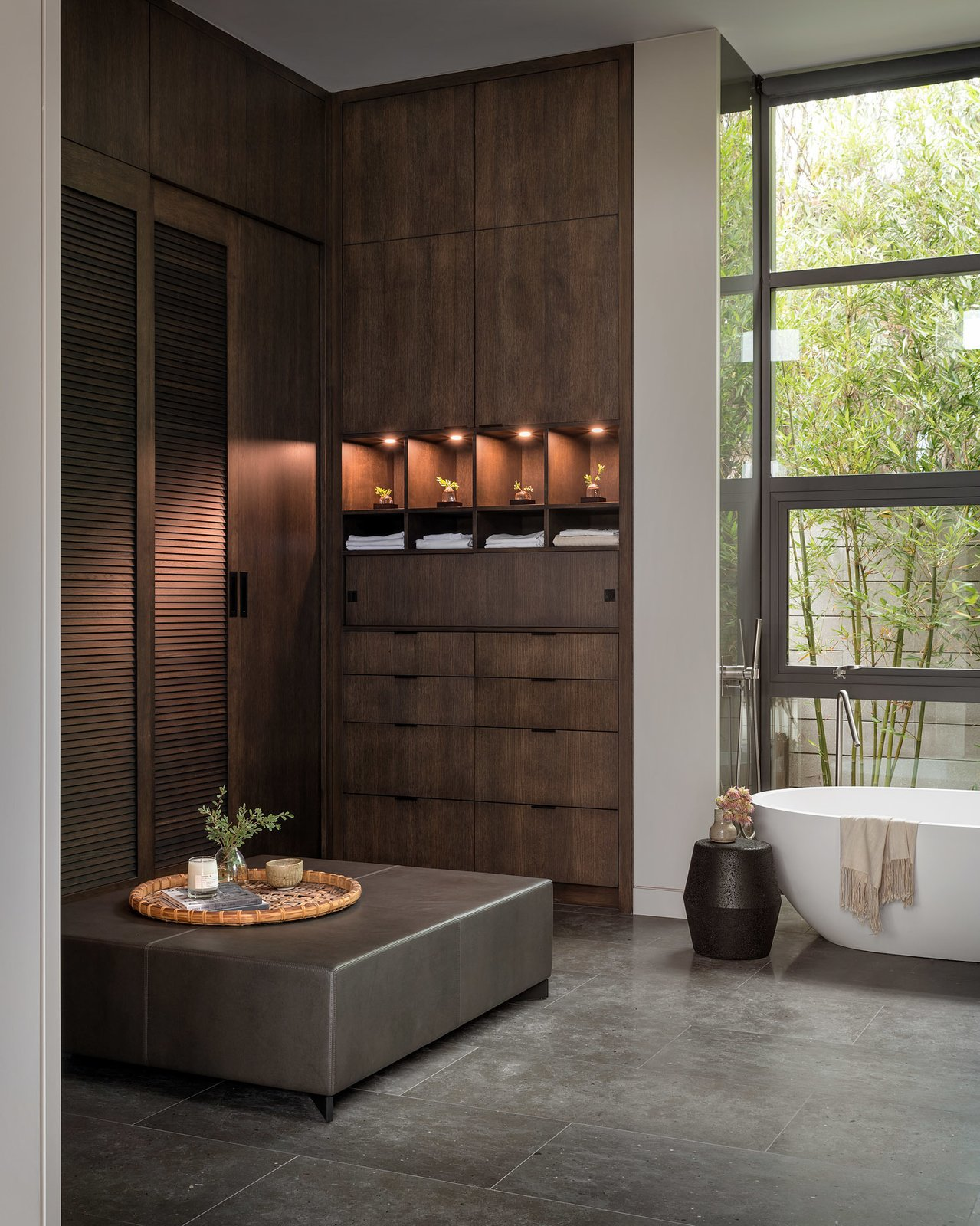 Bath Room, Soaking Tub, Limestone Floor, and Freestanding Tub Dark oak cabinetry provides plenty of storage.  Photo 19 of 23 in A Southern California Midcentury Gets a Serene, Japanese-Inspired Treatment