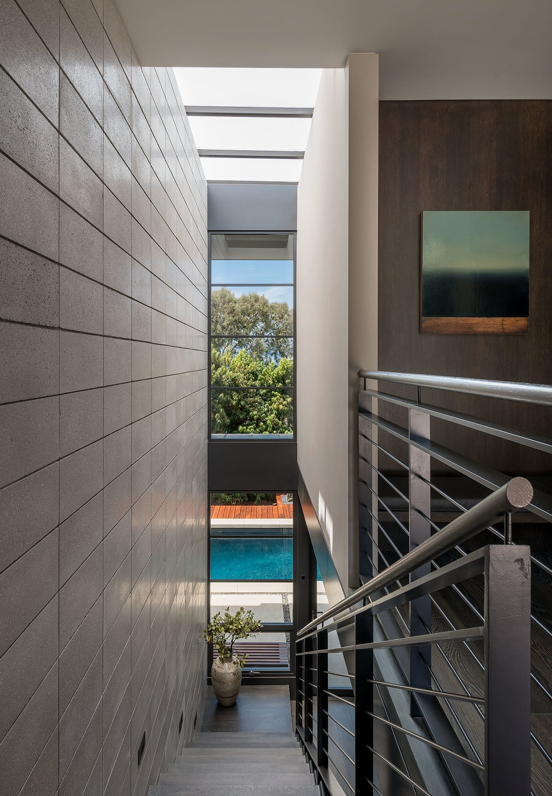 Staircase and Metal Railing Stairs lead down to the pool.  Photo 22 of 23 in A Southern California Midcentury Gets a Serene, Japanese-Inspired Treatment