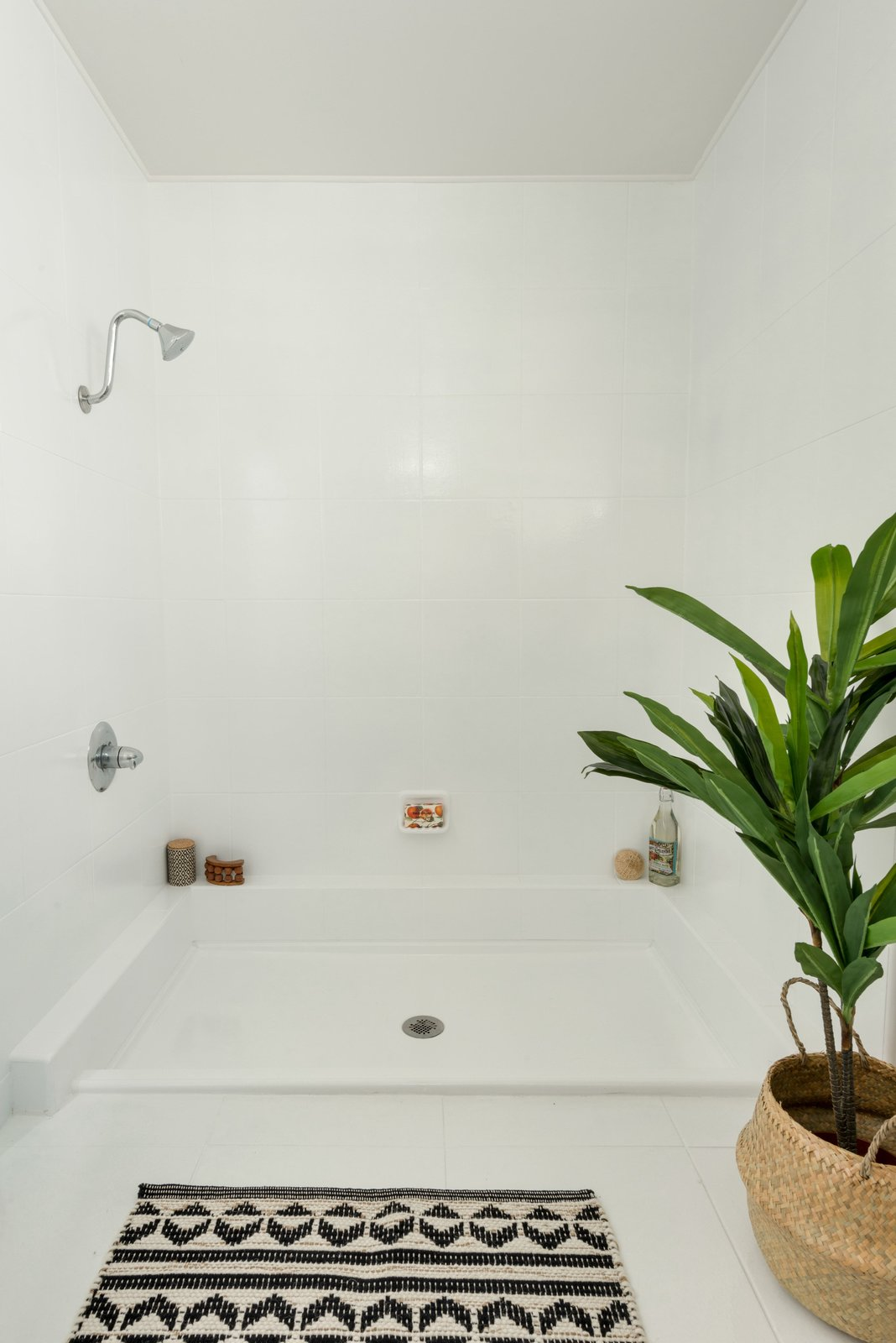 Bath Room, Porcelain Tile Wall, Porcelain Tile Floor, and Open Shower One of the bathrooms.  Photo 13 of 17 in Snag This Hollywood Hills Midcentury Home For $1M